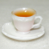 Mary Eccher Filled Cup of Tea with Saucer